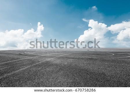 Asphalt road and sky cloud landscape #670758286