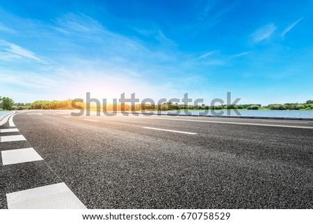 Asphalt road and sky cloud landscape #670758529