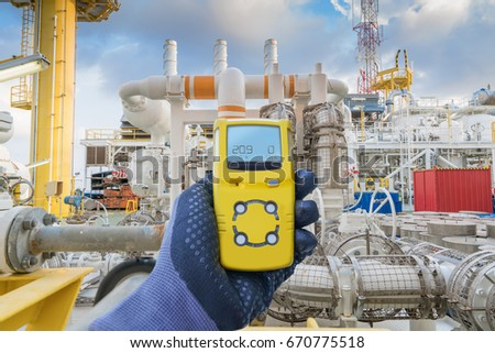 Safety concept of safety and security system on offshore oil and gas processing platform, hand hold gas detector for check hydrocarbon leak to protect fire and explosion. #670775518