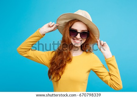 Travel concept - Close up Portrait young beautiful attractive redhair girl wtih trendy hat and sunglass smiling. Blue Pastel Background. Copy space. #670798339