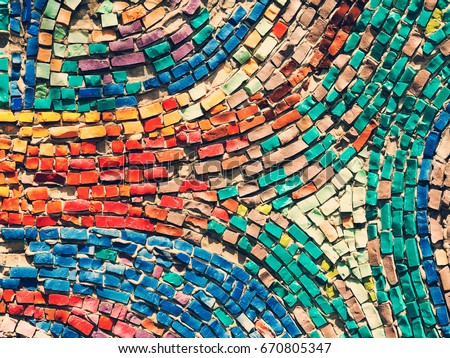 Detail of beautiful old collapsing abstract ceramic mosaic adorned building. Venetian mosaic as decorative background. Selective focus. Abstract Pattern. Abstract mosaic colored ceramic stones