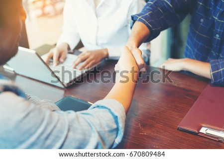 The business team is shaking hands with congratulations on the trade agreement or marketing plan. Handshake Business concept Royalty-Free Stock Photo #670809484
