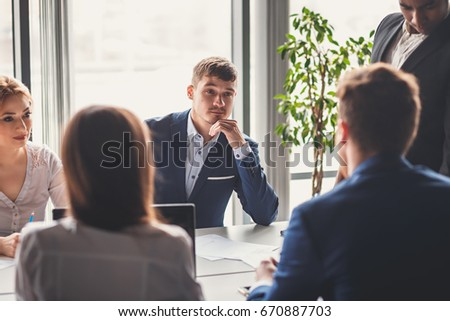 Corporate business team and manager in a meeting #670887703