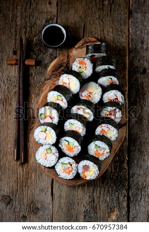Korean roll Gimbap(kimbob) with ham, sausage, carrots, omelet, crab meat and rice.  #670957384