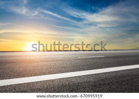 Asphalt road and sky cloud landscape at sunset #670995919