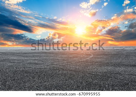 Asphalt road and sky cloud landscape at sunset #670995955