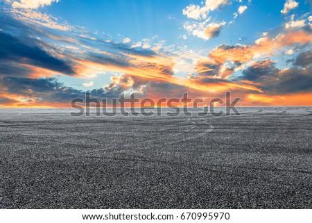 Asphalt road and sky cloud landscape at sunset #670995970
