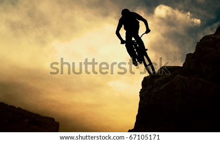 Silhouette of a man on muontain-bike, sunset #67105171