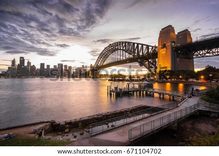 Chilling the tranquility sunset with a beautiful Sydney landmark, Sydney Harbour Bridge Royalty-Free Stock Photo #671104702