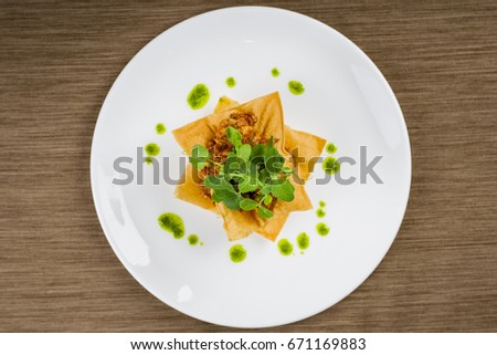 Mexican chicken taco nachos flat lay top view perspective isolated on brown background #671169883