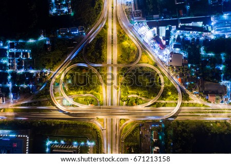 Road beautiful Aerial View of Busy Intersection at Night , top view , thailand .Aerial of Freeway. #671213158