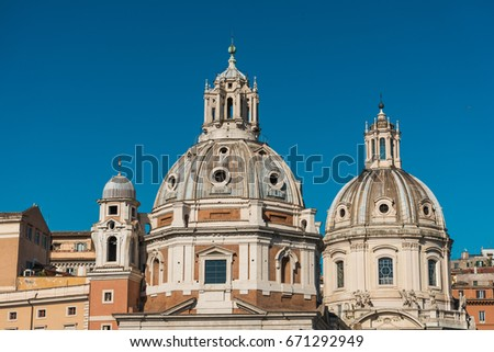 Domes and roofs of historic buildings with clear blue sky in background - Rome, Italy #671292949