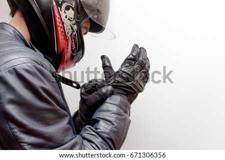 Motorcycle Guy Wearing Helmet and Leather Jacket Gearing Up #671306356