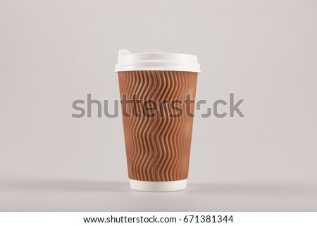 cardboard disposable coffee cup isolated on beige, coffee to go concept #671381344