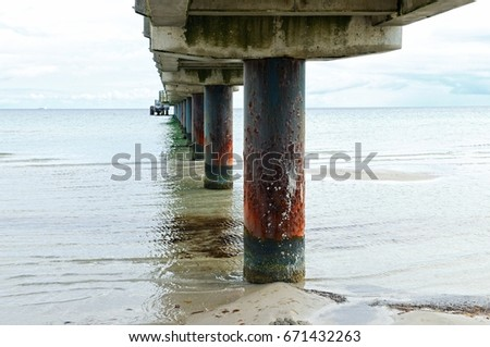 under the pier Schoenberger beach at the Baltic Sea Germany #671432263
