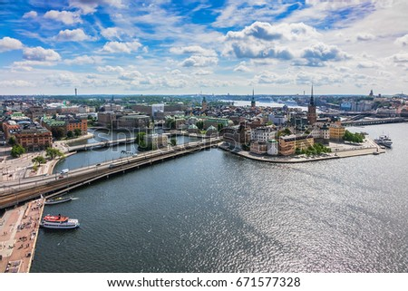 Beautiful aerial view of Stockholm Old town (Gamla Stan) from the observation deck at the City Hall (Stadshuset). Stockholm, Sweden. #671577328