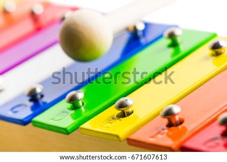 Closeup Detail od Rainbow Colored Wooden Xylophone Isolated on White Background #671607613