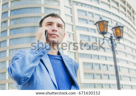 Businessman young handsome caucasian talking on mobile smarth phone #671630152