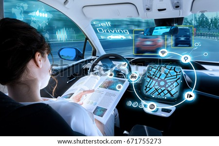 young woman reading a book in a autonomous car. driverless car. self driving vehicle. heads up display. automotive technology.  #671755273