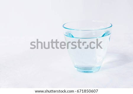 Glass of water on a white background #671850607