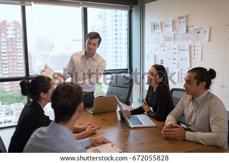Photo young businessman crew working till evening down light with new startup project.Analysis Business Brainstorming Corporate Smart Concept #672055828