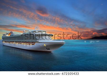 Luxury cruise ship sailing to port on sunrise  Royalty-Free Stock Photo #672105433