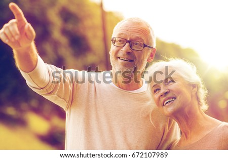 family, age, tourism, travel and people concept - senior couple in park #672107989