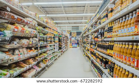 BANGKOK, THAILAND - JULY 5,2017 : Aisle view of a Tesco Lotus supermarket. Tesco is the world's second largest retailer with 6531 stores worldwide. #672282592