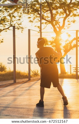 young black handsome man playing basketball on sunrise, morning sports, healthy lifestyle, having fun,  #672512167