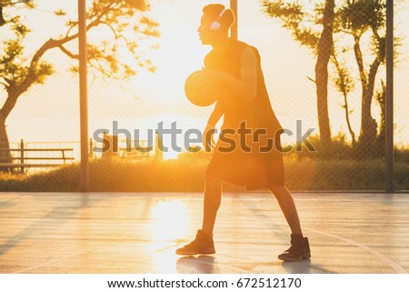 young black handsome man playing basketball on sunrise, morning sports, healthy lifestyle, having fun,  #672512170