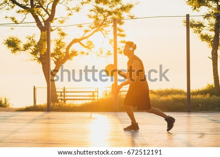 young black handsome man playing basketball on sunrise, morning sports, healthy lifestyle, having fun,  #672512191