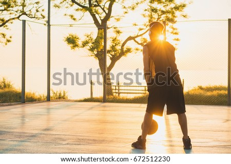 young black handsome man playing basketball on sunrise, morning sports, healthy lifestyle, having fun,  #672512230