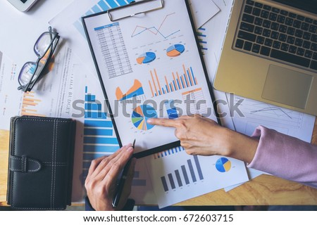 Business team meeting working with new startup project, discussion and analysis data the charts and graphs. Digital tablet calculator, laptop computer using, Business finances and accounting concept. Royalty-Free Stock Photo #672603715