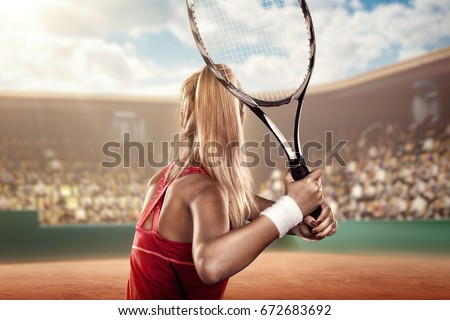 back view of a female tennis player with a racket in action #672683692