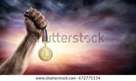 Medal Of First Place In Hand - Victory Concept - Medal 3d Render Royalty-Free Stock Photo #672771154