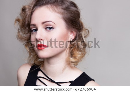Pretty blond girl model like Marilyn Monroe, Madonna in black dress with red lips on white background. 50's Vintage Fashion and Style. Portrait of rich young woman, material girl, femme fatale