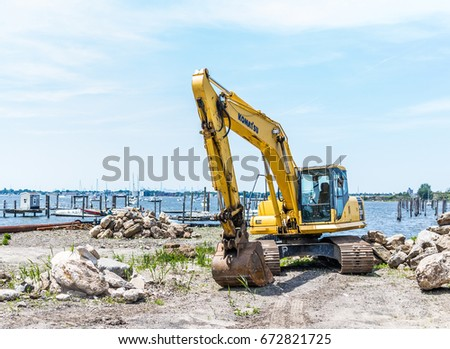 Bronx, NY USA - June 11, 2017: City Island harbor with boats and construction machine #672821725