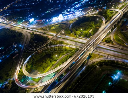 Road beautiful Aerial View of Busy Intersection at Night , top view , thailand .Aerial of Freeway. #672828193