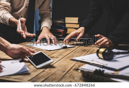 Teamwork of business lawyer meeting working hard about legal legislation in courtroom to help their customer. #672848266