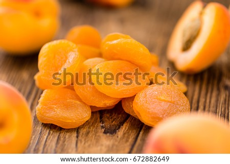 Portion of fresh Dried Apricots (close-up shot; selective focus) #672882649