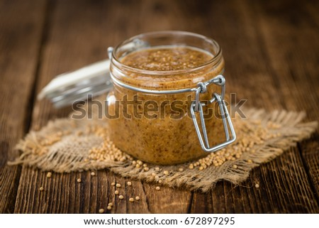 Fresh made German Cuisine (sweet Mustard) on a vintage background (close-up shot) #672897295