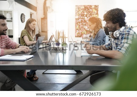 Trendy young people working in co-working office  #672926173
