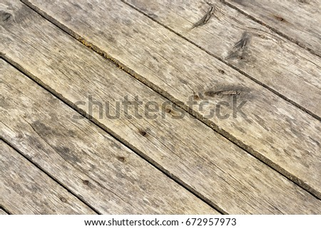 floorboards and old rusty nails, located outdoors. The photo was taken close-up, small depth of field. #672957973