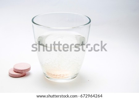 Effervescent tablet (vitamin) in a glass of water. #672964264