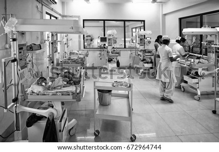 RAXAUL, INDIA - NOV 13: Unidentified Indian nurses working at the neonatal intensive care unit of a hospital on November 13, 2013 in Raxaul, Bihar, India. #672964744