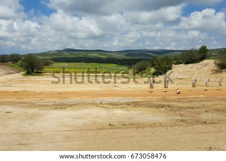 Outdoor shooting range, IDF army soldiers training zone, targets, nature background, Middle East, Israel #673058476