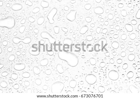 abstract water drops on a white background Royalty-Free Stock Photo #673076701
