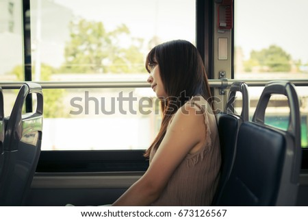 The girl sitting in the bus #673126567