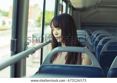 The girl sitting in the bus #673126573