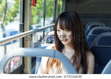 The girl sitting in the bus #673126630